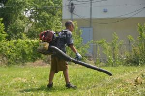 boy using blower on yard