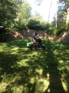 mowing with riding mower